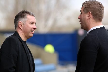 Posh boss Darren Ferguson (left) talks to Oxford manager Karl Robinson before the game. Photo: Joe Dent/theposh.com.