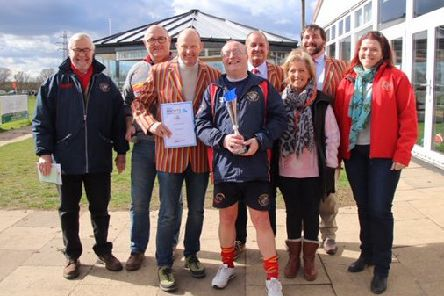 Simon Potter, the Unsung Hero award winner in the Peterborough Telegraph Sports Awards, is pictured after receiving his prize yesterday. With him from the left are Ian Hamilton (secretary), Alan Graham (chairman), Andrew Burgess (president), Archie Bennett (vice-chairman), Margery Beuttell (treasurer), Hugh Burnham (club captain) and Tina Prewer (age grade chair).