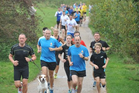 Runners Taking part in the Peterborough Park Run at Ferry Meadows EMN-141018-170556009