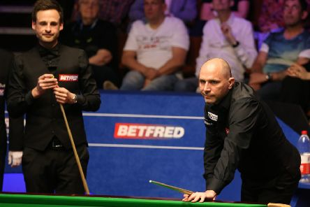Joe Perry (right) and David Gilbert during day three of the 2019 Betfred World Championship at The Crucible.