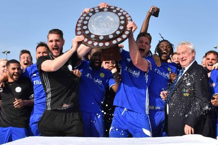 Peterborough Sports players with their Division One Central title-winning trophy. Photo: James Richardson.