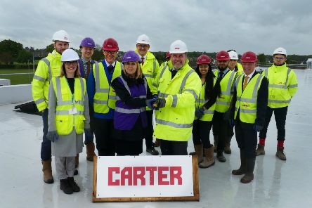 Representatives from the Jack Hunt School, R G Carter and Peterborough City Council at the topping out ceremony on the roof of Jack Hunt School extension.