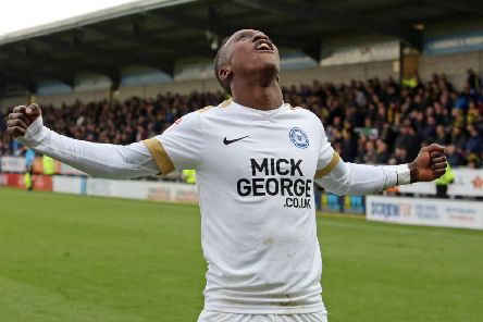 Siriki Dembele celebrates a goal for Posh at Burton last season. Photo: Joe Dent/theposh.com.