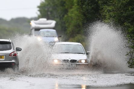 Cars make their way through standing water on the A47 near Peterborough  Photo Joe Giddens/PA Wire EMN-190728-122318001