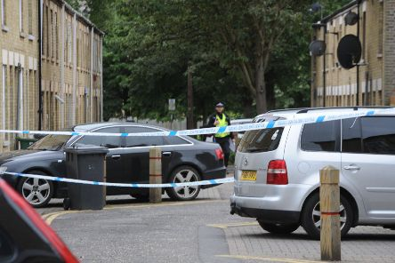 Police at the scene of the stabbing at Crawthorne Street
