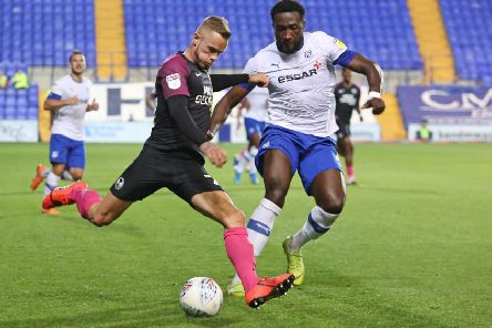 Joe Ward of Peterborough United in action with Emmanuel Monthe of Tranmere Rovers. Photo: Joe Dent/theposh.com
