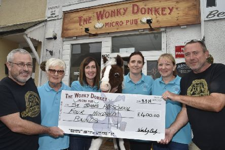 Cheque presentation at the Wonky Donkey, Fletton High Street to members of the St John's pre-school in Stanground