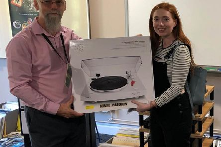 Michaela O'Sullivan receives her prize from Mark Sears of The Missing Link and Vinyl Passion