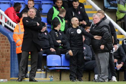 Posh manager Darren Ferguson (left) and Rotherham manager Steve Evans during a game at London Road in 2014.
