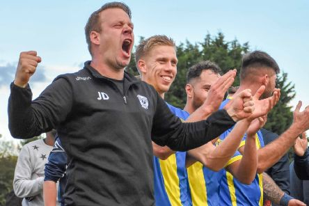 Peterborough Sports manager Jimmy Dean celebrates an FA Cup win over Guiseley. Photo: James Richardson.