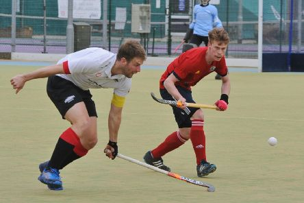 Ross Ambler (red) scored for City of Peterborough against Loughborough Students