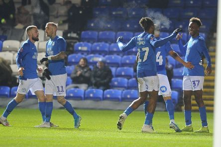 Posh players celebrate Ricky-Jade Jones' late goal v Stevenage. Photo: David Lowndes.