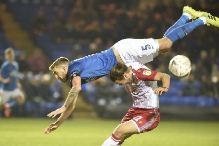 Mark Beevers (blue) in action for Posh.
