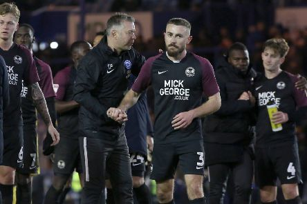 Posh manager Darren Ferguson with Dan Butler after the game at Portsmouth last weekend. Photo: Joe Dent/theposh.com.