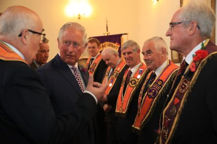 Prince Charles talks to members of the loyal orders during his visit to Brownlow House