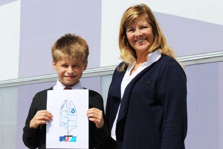 Zak Kay holding his winning design, with America's Cup World Series event director Leslie Greenhalgh