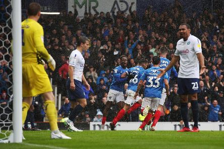 Gareth Evans celebrates after levelling for Pompey with a header. Picture: Joe Pepler