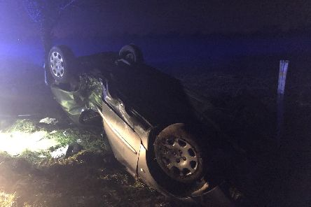 The car on its roof in High Street, Oving 'Picture: PC Tom Van Der Wee / Twitter