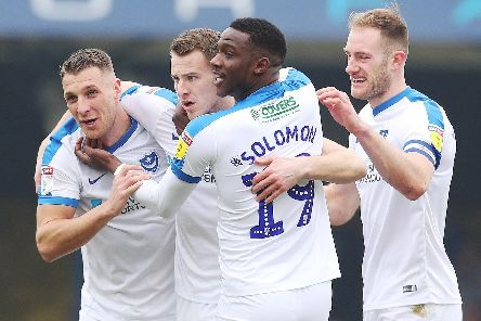 The Pompey players congratulate Bryn Morris, centre, following his eighth-minute opener