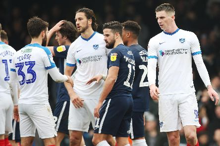 The Pompey players look dejected at the final whistle