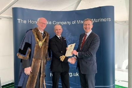Commander Philip Harper (centre) receiving his Chartered Master Mariner status from Second Sea Lord Vice-Admiral Tony Radakin (right) and Master Mariner Captain Robert Booth (left). Picture: Royal Navy