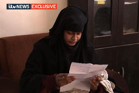 Shamima Begum, 19, in a Syrian refugee camp, being shown a copy of the Home Office letter which stripped her of her British citizenship. Picture: ITV News/PA Wire