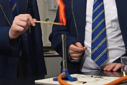 A bunsen burner - the boy is probably wishing he could pick it up and brandish it like a lightsabre