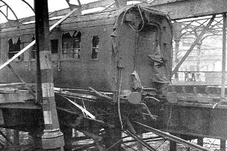 During the air raid of January 10, 1941, Portsmouth Harbour station was wrecked. Here is a carriage hanging off the rails. Picture: T Bye collection.