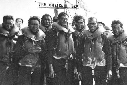 Here we see the German survivors from the sunken U boat. Gordon Walwyn is third from the right marked by an X. Courtesy of STUDIOCANAL Films Ltd.