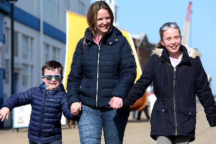 Jane Mattews with her children, Harry, 6, and Jessica, 10 at the taster day at Portsmouth Historic Dockyard, where some visitors were guests of The News'. Picture: Chris Moorhouse (240319-8)
