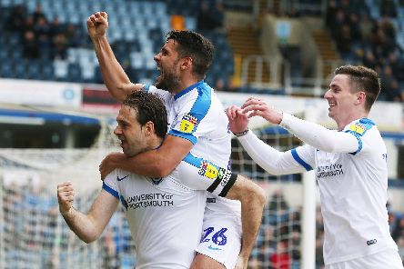 Brett Pitman, Gareth Evans and Oli Hawkins celebrate. Picture: Joe Pepler