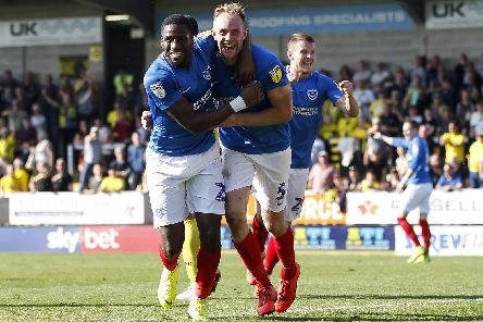 Matthew Clarke of Portsmouth celebrates with Omar Bogle of Portsmouth after the late winner yesterday. (Photo by Daniel Chesterton/phcimages.com)