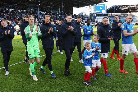 A sombre lap of appreciation from Pompey after their Accrington point booked a play-off semi-final against Sunderland. Picture: Joe Pepler