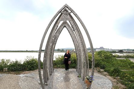 Edwina Abrahams, wife of Maurice Abrahams who died in the Shoreham Airshow crash, views a memorial created by artists Jane Fordham and David Parfitt, to the Shoreham Airshow victims after it was unveiled on the banks of the Adur in Shoreham Picture: Gareth Fuller/PA Wire