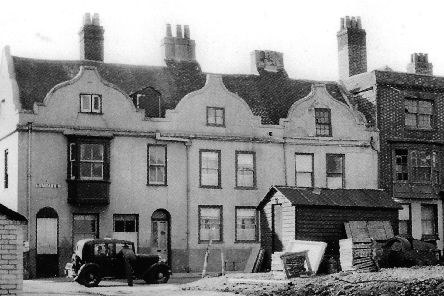 With an air raid shelter on the left and bomb damaged building to the right this can only be a blitz-damaged Lombard Street, Old Portsmouth.