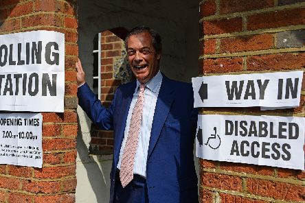 Brexit Party leader Nigel Farage arrives to cast his vote for the European Parliament elections at a polling station at the Cudham Church of England Primary School in Biggin Hill, Kent. Picture: Kirsty O'Connor/PA Wire
