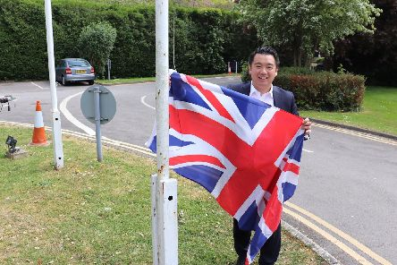 Havant MP Alan Mak with the Union Flag outside his office, in central Havant