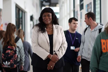 Stella Mbubaegbu, principal of Highbury College, pictured at the college with students. Picture: Chris Moorhouse