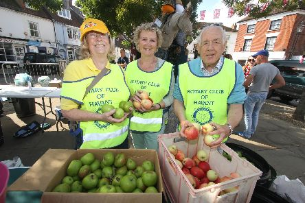 Havant Rotary Club members Jenny Edgell, Vicki King and Mike Coombe at Emsworth Apple Press in 2016.