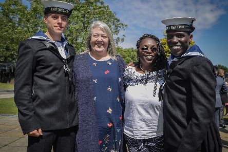 Now-HMS Sultan recruit Cameron Hawes his mum Sarah Hole, Althea Crosby, and her son Quaci Crosby of HMS Raleigh, who was stunned to see his mum at the passing-out parade. Picture: Mark Johnson/Royal Navy