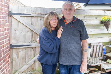 David Nevett with his wife, Penny, near the rear gate of their house where the burglar made his escape. Picture: Habibur Rahman