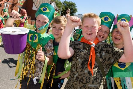 Paulsgrove and Wymering Carnival. Scouts from 53rd Portsmouth Group enthusiastically collect donations to help fund the carnival. Picture: Duncan Shepherd