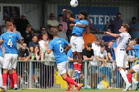 Ellis Harrison rises highest during Saturday's 2-1 victory at the Hawks. Picture: Dave Haines/Portsmouth News