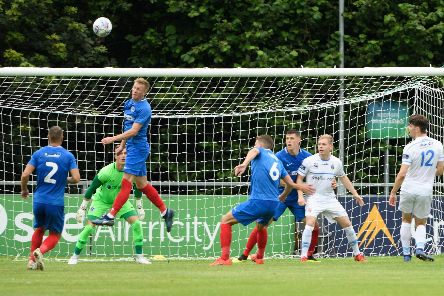 Ross McCrorie heads the ball clear during his first-half outing against UCD. Picture: Arnold Byrne