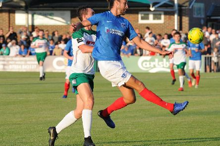 Christian Burgess clears in Pompey's 2-1 victory at the Rocks. Picture: Tommy McMillan