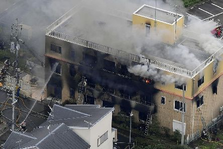 Smoke billows from a three-story building of Kyoto Animation in a fire in Kyoto, western Japan, Thursday, July 18, 2019. Kyoto prefectural police said the fire broke out Thursday morning after a man burst into it and spread unidentified liquid and put fire. Picture: Kyodo News via AP