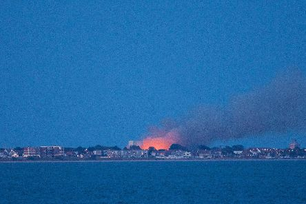 A fire at Browndown in Gosport set by 'idiots' on July 12 seen from Calshot beach on the Isle of Wight. Picture: Jan Sutton