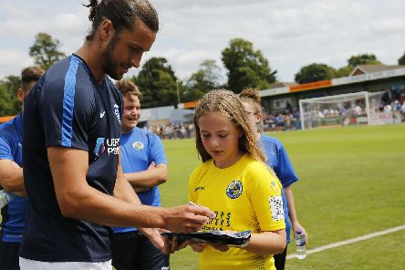 Christian Burgess signs autographs ahead of Pompey's 2-1 friendly victory over the Hawks. Picture: Dave Haines/Portsmouth News
