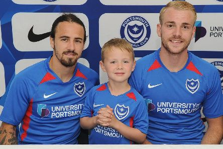 Ryan Williams, left, seen here with Jack Whatmough and five-year-old Brody King at the unveiling of Pompey's new kit, is back in training after injury. Picture: Habibur Rahman