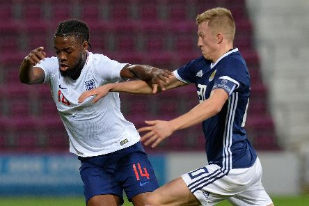 Ross McCrorie battles Joshua Onomah for the ball for Scotland under-21s against England. Picture: Mark Runnacles/Getty Images